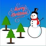 Subtítulos de la Feliz Navidad con los árboles del muñeco de nieve y de pino Fotografía de archivo