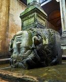 Subterranean Basilica Cistern. Istanbul, Turkey. Upside-down head of Medusa located at the northwest edge of the subterranean Basilica Cistern, also known as royalty free stock photography