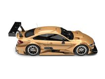 Subtle gold modern super race car - top down side view Stock Photo