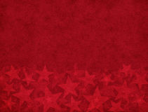 Subtle Star Foreground. Subtle star shapes on a red textured background Stock Image