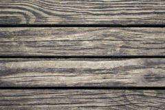 Subtle wood planks closeup. Rough lumber surface. Warm brown wooden background for vintage card. Royalty Free Stock Photos