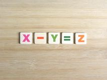 Subtraction in algebra. Subtraction concept in algebra X-Y=Z on wood background royalty free stock photos