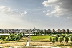 Suburb and city skyline. View from an artificial hill towards the suburb of Carnisselande with the Rotterdam skyline in the distance Stock Photography