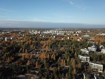 The suburb in Finland soon under the clouds. Autumn is coming to our suburb and the trees will have different colors than in summer royalty free stock image