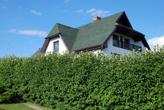Suburb house. White suburb house with green roof stock photo