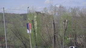 Suburb of Novosibirsk. NOVOSIBIRSK REGION, RUSSIA - MAY 13, 2017: View from suburban train arriving at the station, suburb of Novosibirsk stock video footage