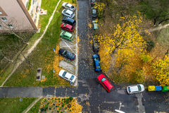 Suburb parking place in residential zone at November, top view Royalty Free Stock Photo