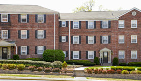 Suburban Apartment Building. Front view of three story garden apartment building complex Royalty Free Stock Photos