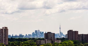 Suburban apartment buildings against dense Toronto downtown in b Stock Images