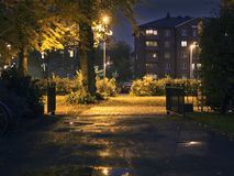 Suburban area during night-time. Dark setting with some lights and colors. stock photo