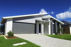 Suburban Australian House. New suburban Australian house with small SOLD sign Royalty Free Stock Photo