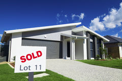 Suburban Australian House. New suburban Australian house with large SOLD sign Stock Images