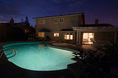 Suburban backyard pool in the evening Stock Photos
