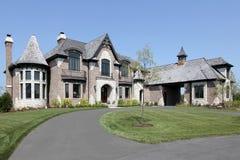 Suburban brick home with circular driveway Stock Images