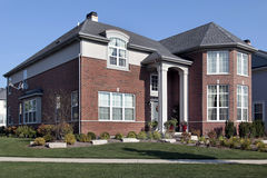 Suburban brick home with columns Royalty Free Stock Photos