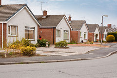 Suburban bungalows on housing estate. Row of modern suburban bungalows on a housing estate in suburbia royalty free stock photo