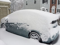 Suburban car covered from snowstorm Stock Photo