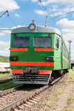 Suburban electric train. Green train is on a railway line Stock Photos