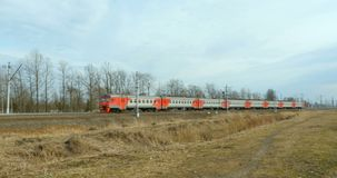 Suburban Electric Train in Motion. St. Petersburg, Russia, 30 March 2018 Russian Railways, Suburban Electric Train in Motion stock footage
