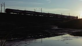 Suburban Electric Train Passes Over The Railway Bridge On Sunrise. Trans-Siberian Railway, Full HD Resolution 1920x1080 Video Frame Rate 29.97 Length 0:17 stock video