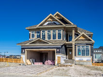 Suburban estate home under construction. In Aspen Woods in Calgary, Alberta. This estate home is typical of upscale Calgary suburban districts Stock Photography