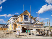 Suburban estate home under construction. In Aspen Woods in Calgary, Alberta. This estate home is typical of upscale Calgary suburban districts Stock Photos