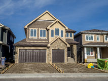 Suburban estate home under construction. In Aspen Woods on May 17, 2014 in Calgary, Alberta. This estate home is typical of upscale Calgary suburban districts Stock Photography