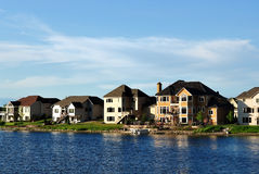 Suburban Executive Homes on Lake Royalty Free Stock Image
