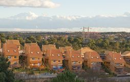 Suburban Expansion. New Housing road on a hill Stock Images