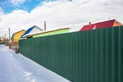 Suburban fence of corrugated iron coated Stock Photo