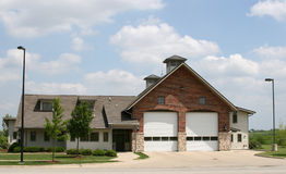 Suburban Fire House. Fire,station,house,building,architecture,suburban,midwest,retirement,community,blue,sky,clouds Royalty Free Stock Photography