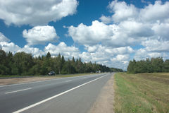 Suburban highway in summer day Royalty Free Stock Photography