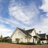 Suburban home. New house in suburban street with closed roller shutters stock images