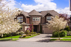 Suburban home. A modern style residential suburban home with blue sky and clouds royalty free stock photography