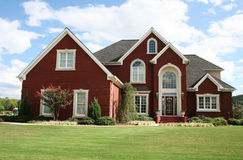 Suburban home. New family suburban home with a big yard Royalty Free Stock Image