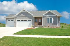 Suburban Home. A beautiful vinyl siding home in the suburbs in Michigan Royalty Free Stock Images