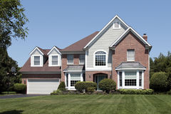 Suburban home with arched entry Stock Photos
