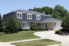Suburban home with circular drive Stock Photos
