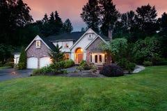 Suburban home at dusk stock photos