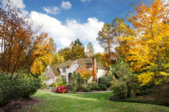 Suburban home in fall. Suburban home in Autumn sunshine as the leaves turn orange & yellow Royalty Free Stock Image
