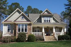 Suburban home with stone and siding exterior royalty free stock images