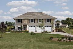 Suburban home with three car garage Stock Images