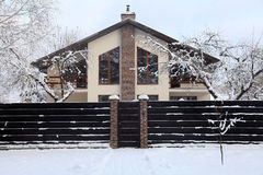 Suburban home under snow in winter Stock Images