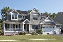 Suburban home with wraparound porch Stock Photo