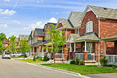 Suburban homes. Suburban residential street with red brick houses royalty free stock photography