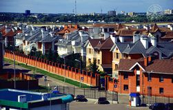 Summertime Suburban homes, sunny day. Suburban homes in Kazan during summertime green grass lush trees Stock Images