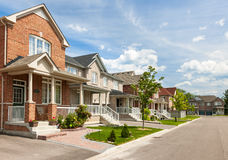 Suburban homes. Suburban residential street with red brick houses Royalty Free Stock Image