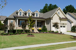Suburban house. With porch and neat landscaping Royalty Free Stock Image