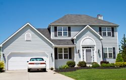 Suburban House. An American Ohio suburban home - neat and tidy. One car in the driveway royalty free stock photos