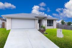 Suburban house front. Modern suburban house on sunny day stock image